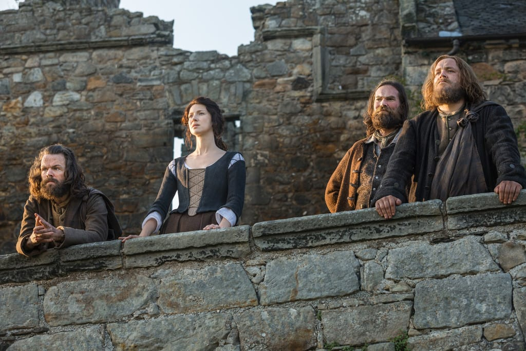 'Outlander' Season 1B Angus Mhor (Stephen Walters), Claire Randall Fraser (Caitriona Balfe), Murtagh Fitzgibbons (Duncan Lacroix), and Rupert (Grant O'Rourke)