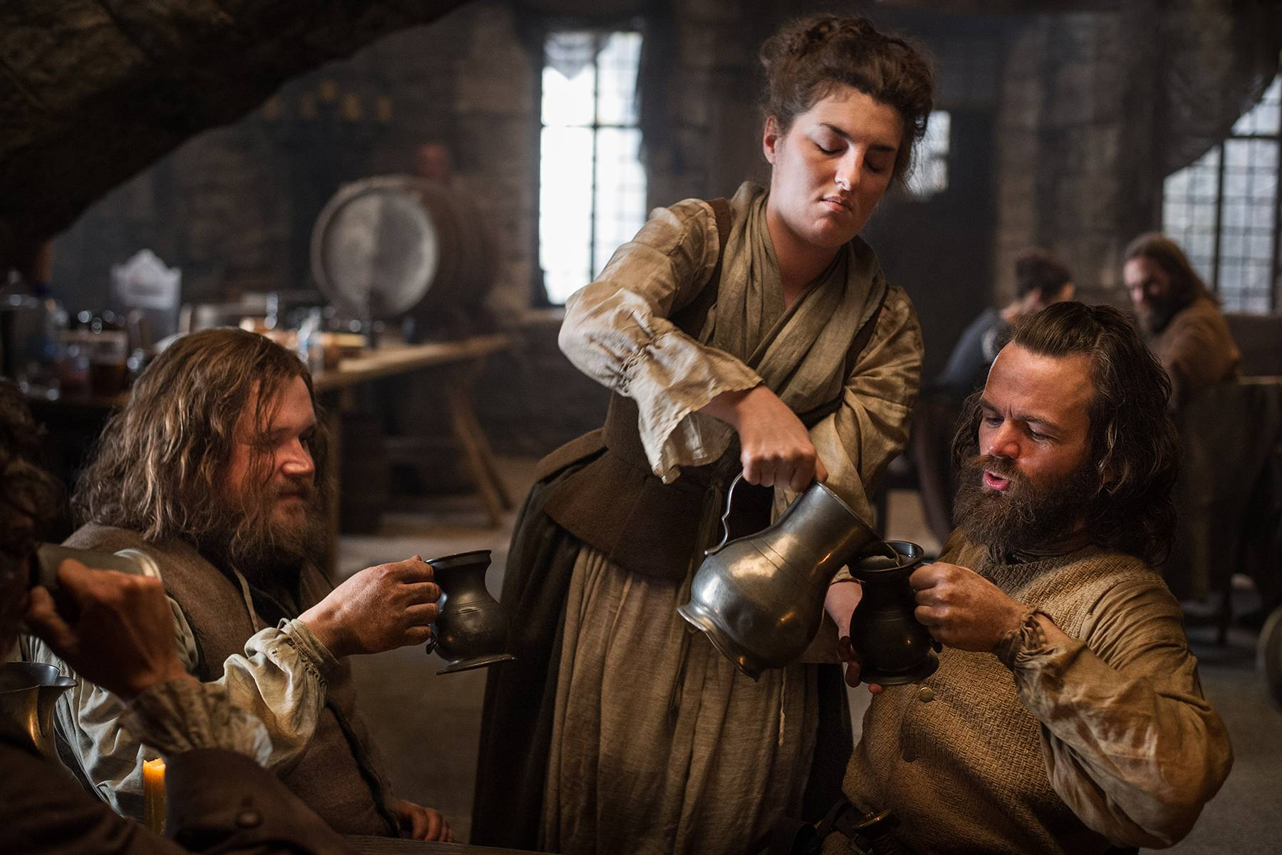 Stephen Walters (Angus Mhor), Caitriona Balfe (Claire Randall Fraser), Duncan Lacroix (Murtagh Fitzgibbons), and Grant O'Rourke (Rupert Mackenzie)
